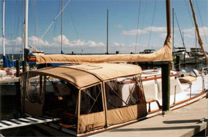 This sailboat is well-protected with a full cockpit enclosure, dodger and sail covers
